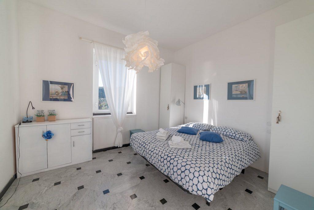 Fotografia d'interni: Camera da letto a Rapallo
